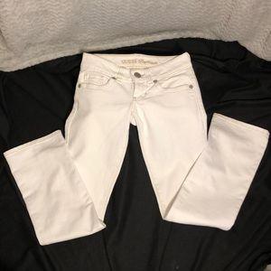 White Guess stretch, straight leg jeans.